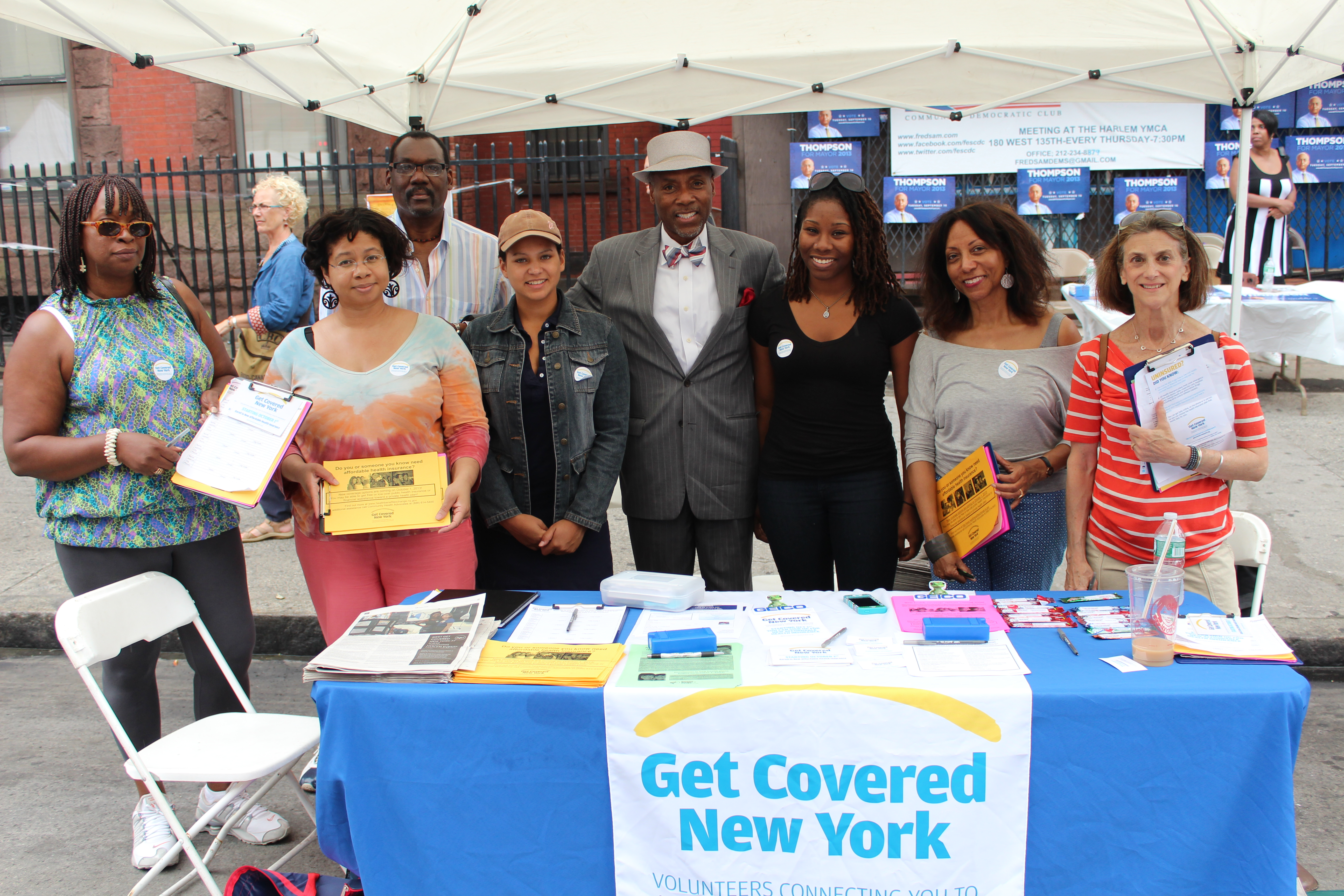 """Get Covered New York"" volunteers at Harlem Week, posing with State Sen. Bill Perkins (center with hat) who stopped by our table to see what we were doing."
